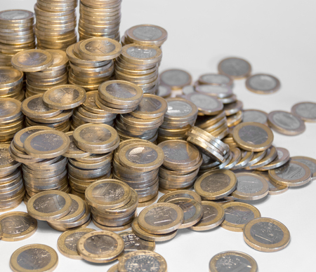 Lots of stacked 1 euro coins Stock Photo