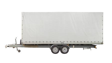 sideways shot of a white trailer in white back Stock fotó