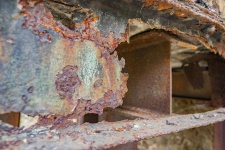 weathered rusty detail showing a et away steel girder