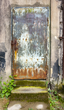rotten architectural scenery including a corroded door Stock Photo