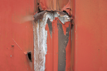 weathered rusty paint-coated metallic background