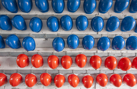 lots of blue and red protective helmets Stock Photo