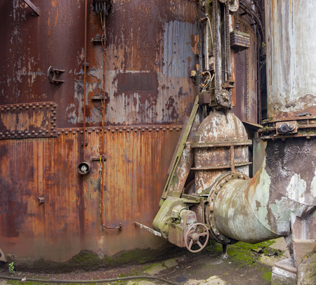 weathered rusty industrial scenery with old corroded appliances Stock Photo