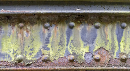 weathered rusty detail showing a corroded steel girder