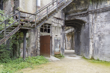rotten industrial architectural scenery including a rundown stairway Stock Photo