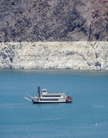 hoover dam: ship at Lake mead near the Hoover Dam in the Black Canyon at the Colorado River in USA