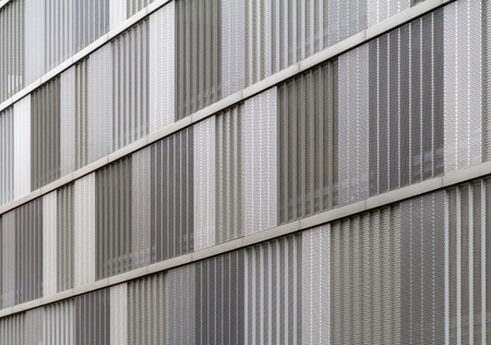 full frame detail of a house facade cased with metallic perforated plates