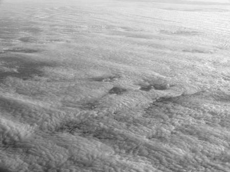 high angle aerial view above dense clouds Banco de Imagens