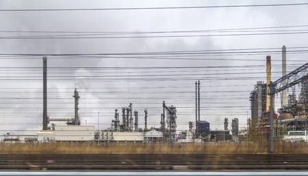 industrial roadside scenery including fabrics and refinery Banco de Imagens