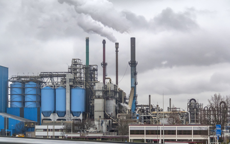 industrial roadside scenery including a fabric and refinery Stock Photo
