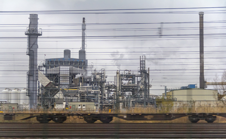 industrial roadside scenery including fabrics and refinery Stock Photo