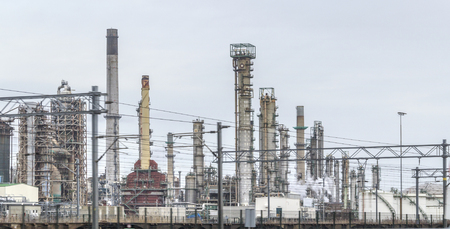 industrial roadside scenery including fabrics and refinery Editorial
