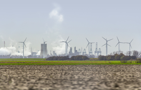 industrial roadside scenery including power plants and wind turbines