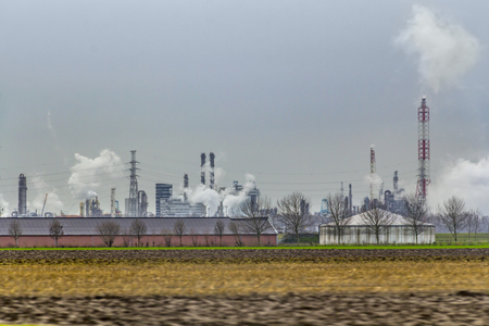 industrial roadside scenery including power plants, fabrics and refineries Editorial