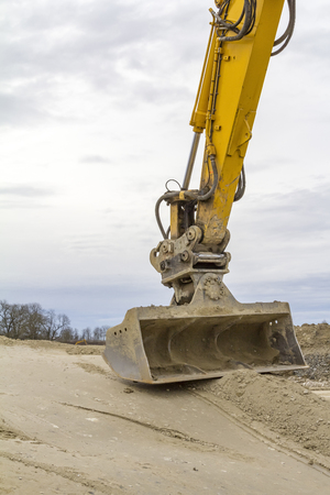 excavator shovel on compressed loamy ground at a construction site