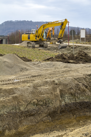 excavators at a loamy construction site