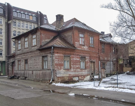 rundown wooden old house seen in Riga at winter time