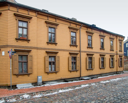 wooden old house facade seen in Riga at winter time