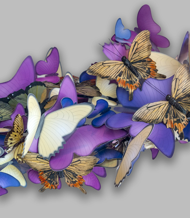 Colorful butterfly ornament made of paper in light grey back with shadow