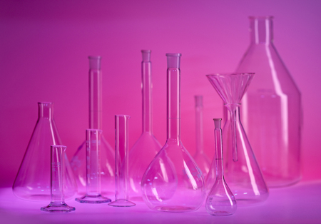 Variety of laboratory glassware in violet ambiance