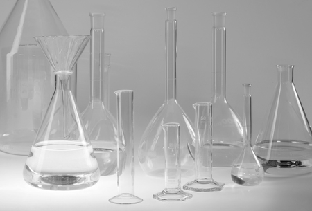 Variety of partly filled laboratory glassware Standard-Bild - 115382117