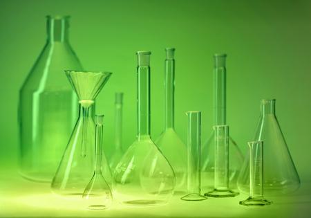 Variety of laboratory glassware in green ambiance Standard-Bild - 115382076