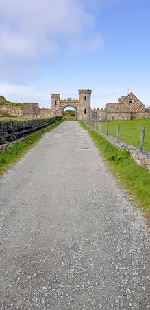 Historic building with archway seen in western Ireland Standard-Bild - 115382007