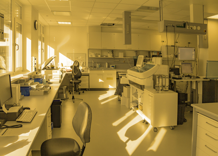 Warm toned scenery showing a medical laboratory including lots of apparatuses and technical equipment Standard-Bild - 115382013