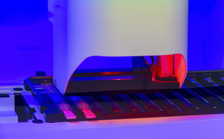 Colorful illuminated detail of a medical apparatus in a laboratory Standard-Bild - 115381915