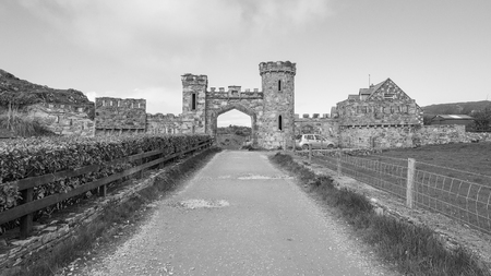 Black and white photo of a historic building with archway seen in western Ireland