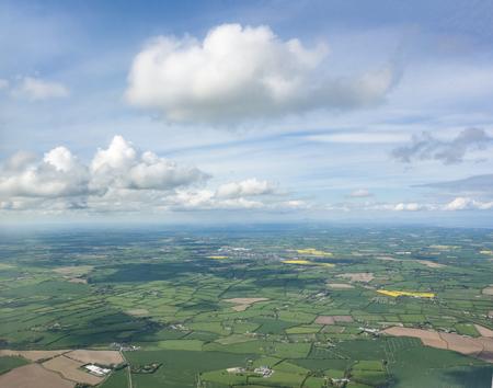 Aerial scenery above Ireland in sunny ambiance Standard-Bild - 115381842