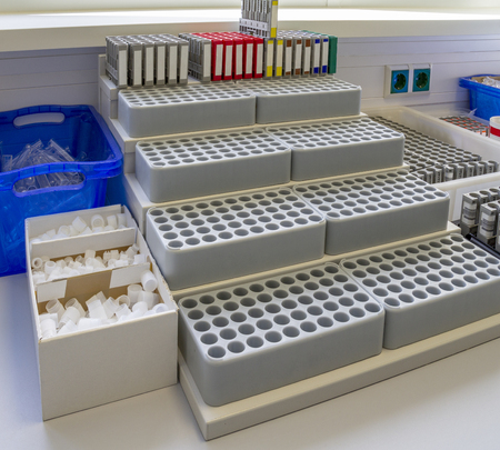 Closeup shot of medical sample racks Standard-Bild - 115381849