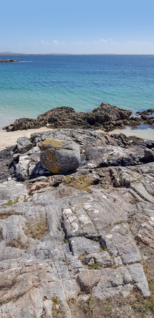 Rocks at the beach Imagens