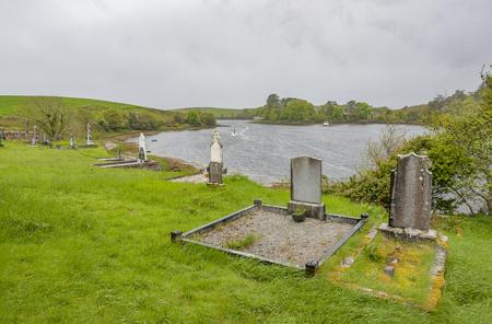 waterside scenery showing a old graveyard seen in Connemara, a region in Ireland