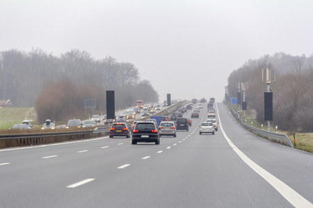 Misty highway scenery at winter time in Southern Germany Imagens