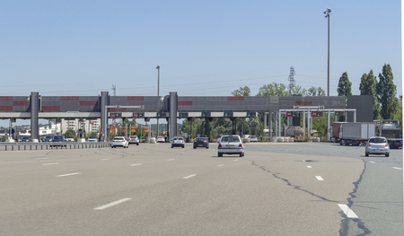 Sunny scenery showing a toll station on a highway in France