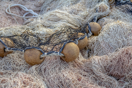 full frame picture showing a tangled fishing net