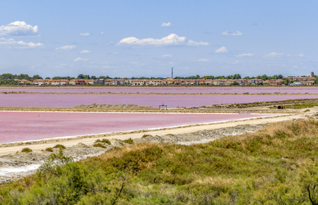 scenery around Salin-de-Giraud located in in the Camargue area in southern France wich is showing lots of salt evaporation ponds in sunny ambiance Foto de archivo