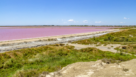 scenery around Salin-de-Giraud located in in the Camargue area in southern France wich is showing lots of salt evaporation ponds in sunny ambiance Standard-Bild