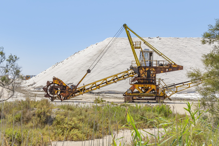 Bucket-wheel excavator near a salt production facility around Salin-de-Giraud located in in the Camargue area in southern France