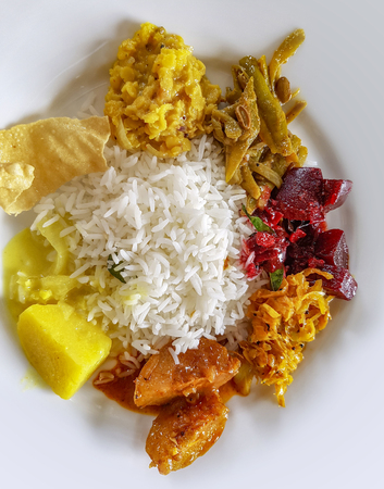 traditional dish with rice and vegetables on a plate seen from above in Sri Lanka