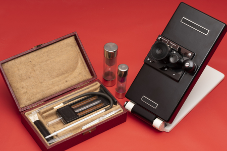 Set of historic medical instruments used for blood analysis in red back