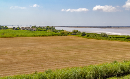 Scenery near salt evaporation pond in the Camargue area in southern France