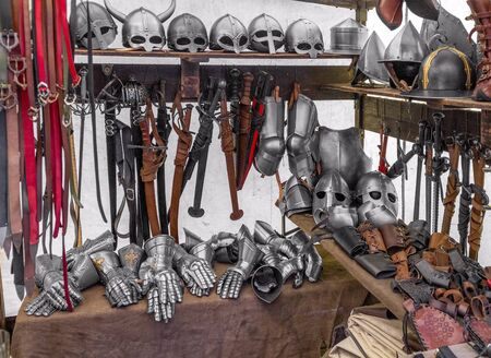 some weapons and other equipment seen at a medieval market Stock Photo - 132034214