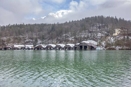 Scenery including lots of boathouses at Schoenau am Koenigssee in Bavaria at winter time