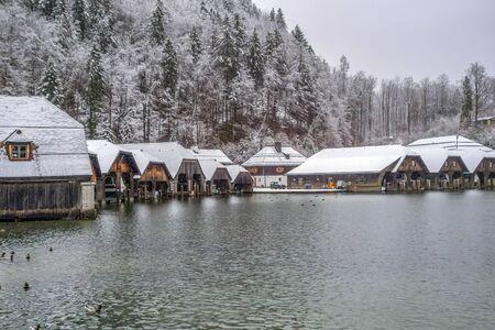 boathouses around Schoenau am Koenigssee in Bavaria at winter time
