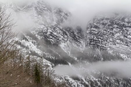 alpine mountain scenery around the Hirschau peninsula at the Koenigssee lake in Bavaria at winter time