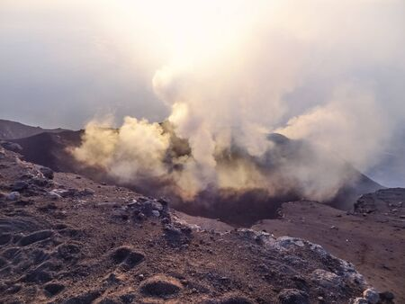 smoky crater scenery at Stromboli volcano near Sicily at evening time Foto de archivo