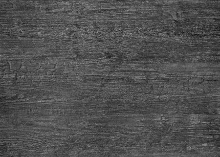 una superficie con venature del legno bruciato scuro full frame