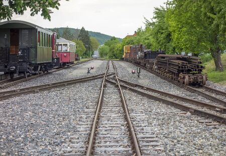 nostalgic railway scenery with rails and railway carriages